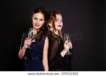 close-up  two young women with glasses of wine - stock photo
