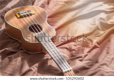 Close up ukuleles on wooden background., copy space