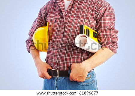 Close-up unrecognizable builder with the tools and a helmet under his arm - stock photo