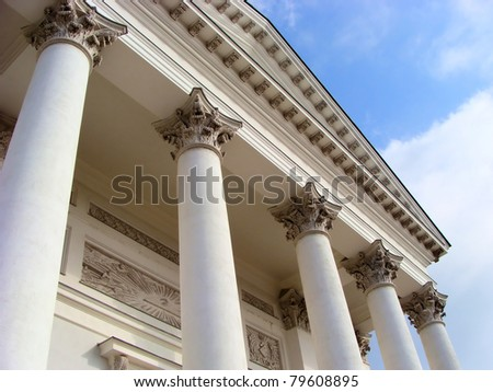 Close up, upward view of a colonnade of white corinthian columns - stock photo