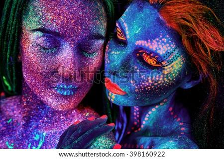 close up uv portrait of 2 woman - stock photo