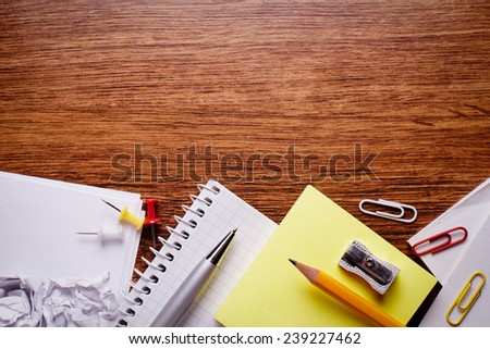 Close up Various Educational Supplies and on Brown Wooden Table with Copy Space for Texts . - stock photo