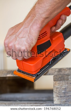 Close up view at the wood sanding - stock photo
