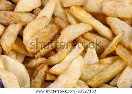 Close up view of a bunch of fried potatoes in slices. - stock photo