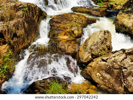 Close-up view of a cascade on the Datanla waterfall in Da Lat city (Dalat), Vietnam. Da Lat and the surrounding area is a popular tourist destination of Asia. - stock photo