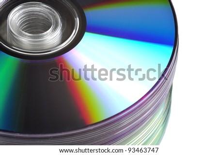 Close up view of a CD/DVD stack on a mirror - stock photo