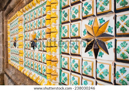 Close-up view of a eight point star and of typical colored tiles from Caltagirone used  as ornament along one of the main street of the town - stock photo