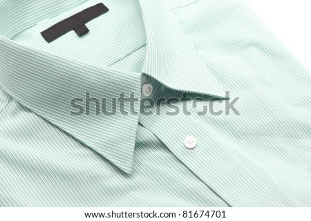 Close up view of a generic green business shirt with a line pattern - stock photo