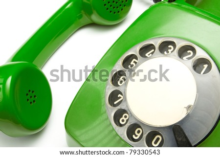 close up view of a green old phone. - stock photo