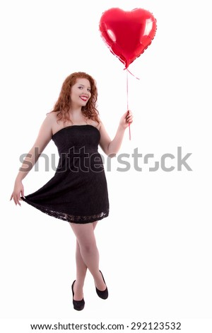 Close up view of a happy young girl holding a red balloon.