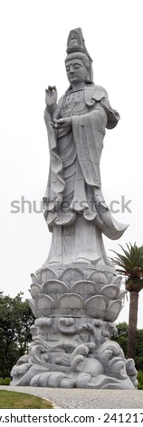 Close up view of a huge beautiful Buddha statue on a park. - stock photo