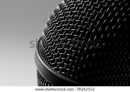 Close-up view of a modern black microphone - stock photo