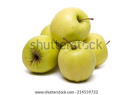 Close up view of a pile yellow apples isolated on a white background. - stock photo