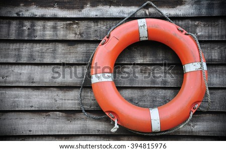 Close-up View of a Seaside Life Buoy on a Wooden Wall - stock photo