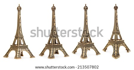 Close up view of a small Eiffel tower statue photographed with different perspectives on white background - stock photo