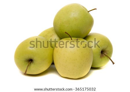 Close up view of a tasty yellow apples fruits isolated on white background. - stock photo