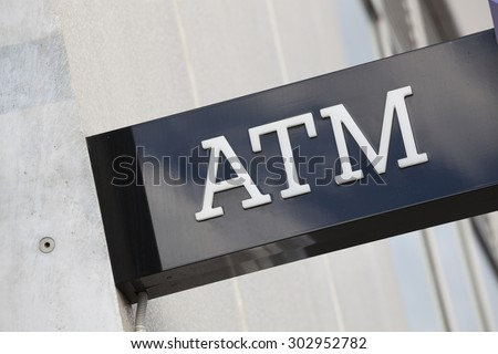 Close-up view of an ATM sign of a bank - stock photo