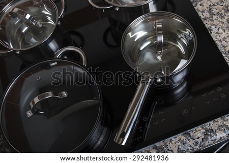 Close up view of an electrical kitchen induction ceramic hob.