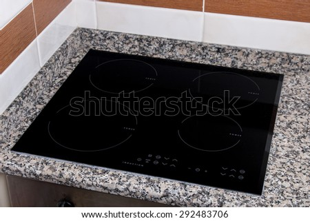 Close up view of an electrical kitchen induction ceramic hob.  - stock photo