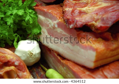 Close up view of bacon with bulb, paprika and parsley decoration - stock photo