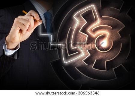 Close up view of businessman drawing way in labyrinth - stock photo