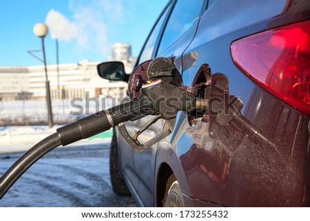 Close up view of car refuel in gas station - stock photo