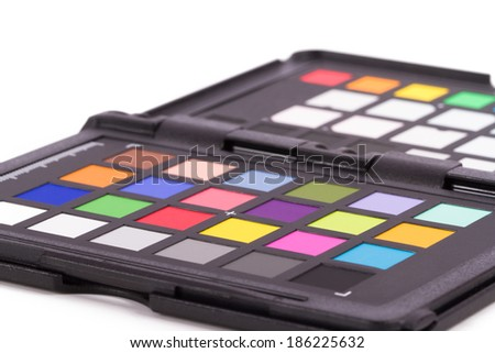 Close up view of color checker equipment of professional photographer for adjust and balance photograph, isolated on white background.