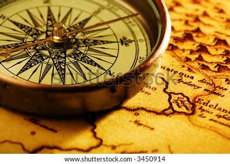 Close up view of compass and old map - stock photo
