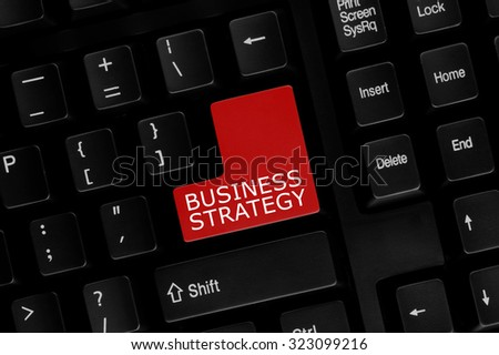 Close-up view of computer keyboard with Business Strategy words on keyboard button. - stock photo