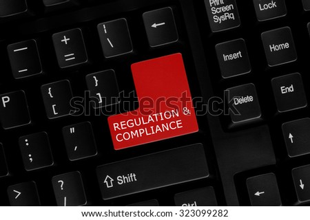 Close-up view of computer keyboard with Regulation & Compliance words on keyboard button. - stock photo