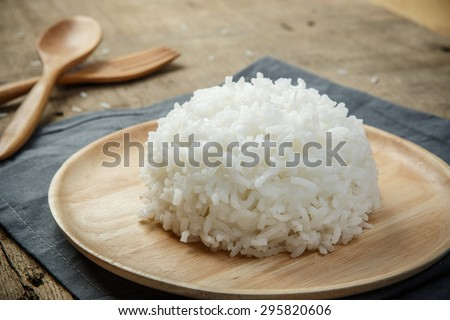 Close-up view of cooked white rice with napery and wooden spoon - soft focus