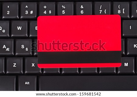 Close up view of credit card on black computer keyboard, top view. - stock photo