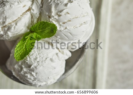 Close-up view of delicious freshly ice cream with leaf of mint on top