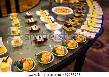 Close-up view of dessert buffet with delicious sweet bakery and coffee-shakes