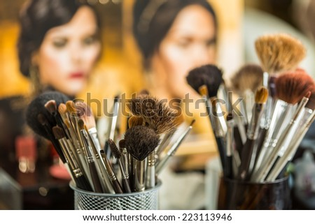 Close up view of different cosmetic brushes for makeup on a dressing table  - stock photo