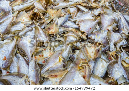 Close-up view of fish being dried in the traditional way, Vietnam - stock photo