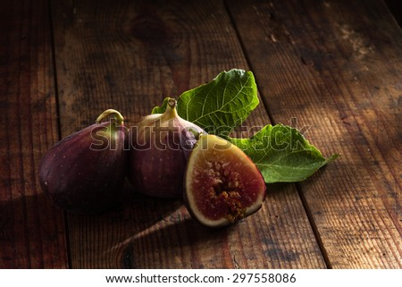 close up view of fresh figs on color back - stock photo