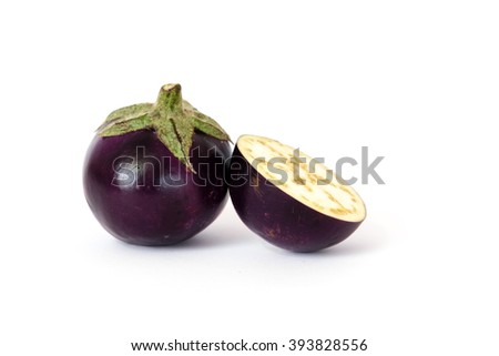 Close-up view of fresh organic raw ripe Eggplants (or Brinjal, aubergine) and half cut segment isolated on white background. - stock photo