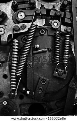 Close Up View Of Gears Of Old Ofset Print Machine - stock photo