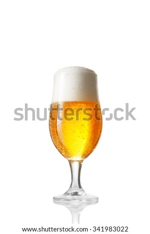 close up view of  glass filled with beer on whte back