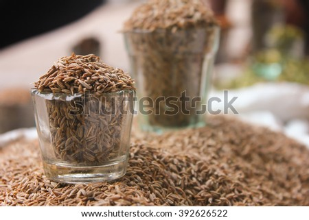 Close-up view of glass filled with Cumin seeds, jeera - stock photo