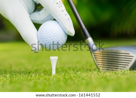 Close up view of golf ball on tee on golf course - stock photo