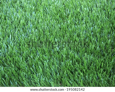 Close up view of green artificial grass turf background - stock photo