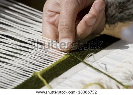 Close-up view of handloom weaver hands - stock photo
