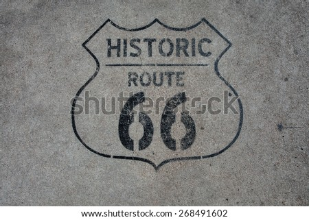close up view of  historic rout 66 mark on asphalt  surface