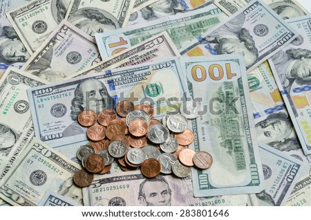 Close-up view of hundred dollars banknote and coins cents - stock photo