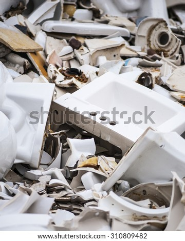 Close-up view of large porcelain and ceramic wreckage pile, shallow DOF - stock photo