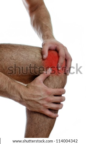Close up view of male hands holding his sore knee. Isolated on white.