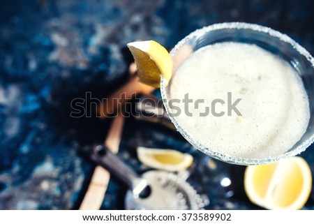 close-up view of margarita cocktail. Details of fancy beverage on metal background - stock photo