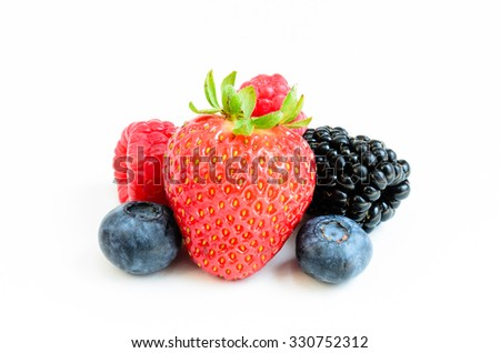 Close-up view of mixed, assorted berries blackberry, strawberry, blueberry, raspberry isolated on white background. Colourful and healthy concept. Black, blue, red, green color - stock photo